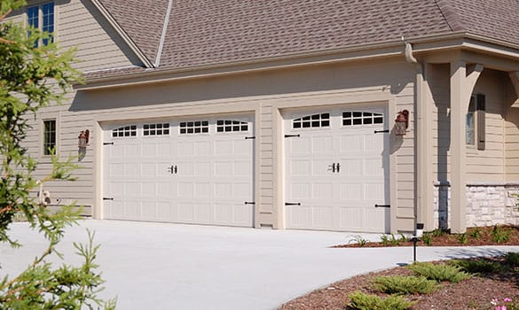 ia door three newest wooden classy medium garage sectional rapids grand cedar car with eastern image security in doors